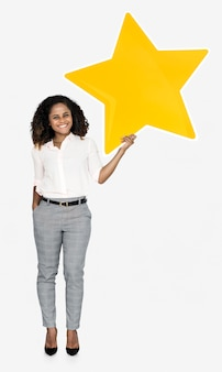 A cheerful woman holding a star