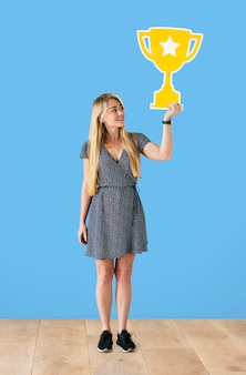 Cheerful woman holding a trophy icon