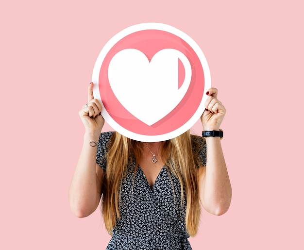 Cheerful woman holding valentine's icon
