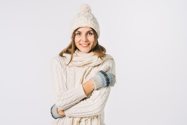 Cheerful woman in knitted clothes feeling cold