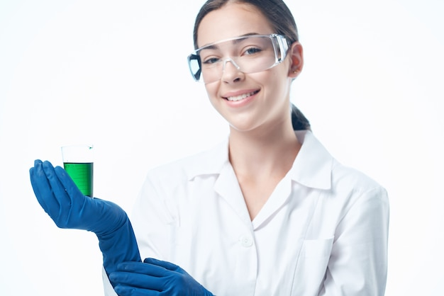 Cheerful woman laboratory assistant in a white coat research science diagnostics