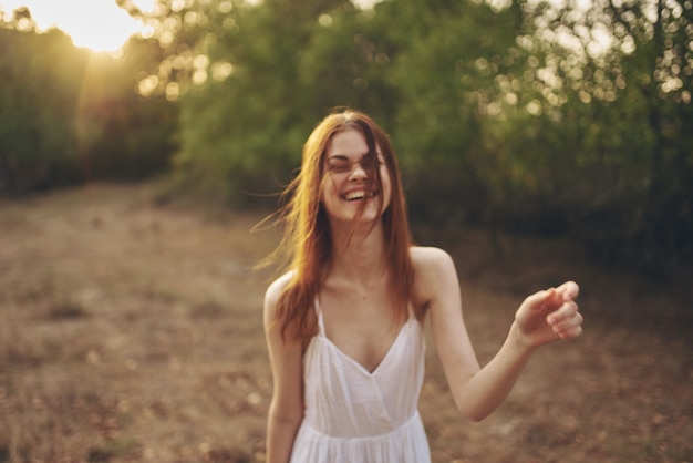 Cheerful woman outdoors in the field freedom lifestyle