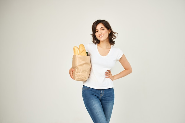 Cheerful woman paper bag of groceries vegetables delivery