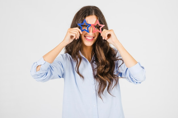 Cheerful woman in star-shaped glasses