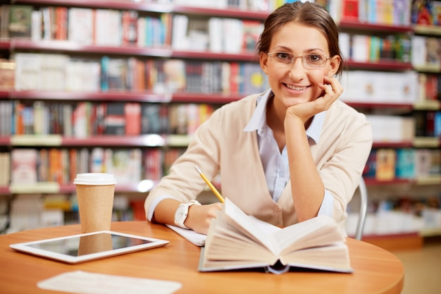 Cheerful woman studying literature