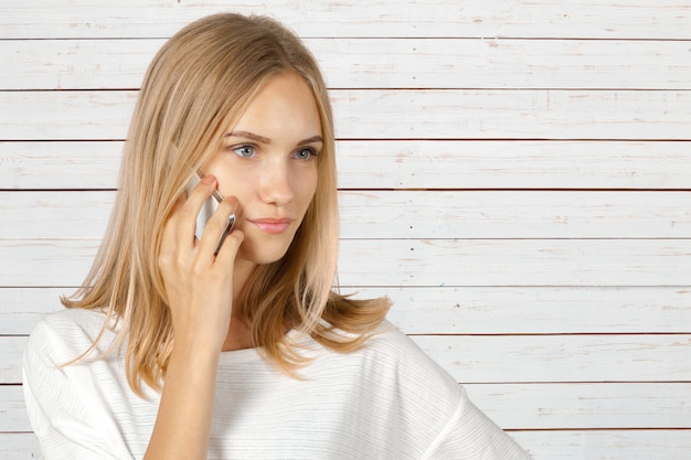 Cheerful woman talking on the phone isolated