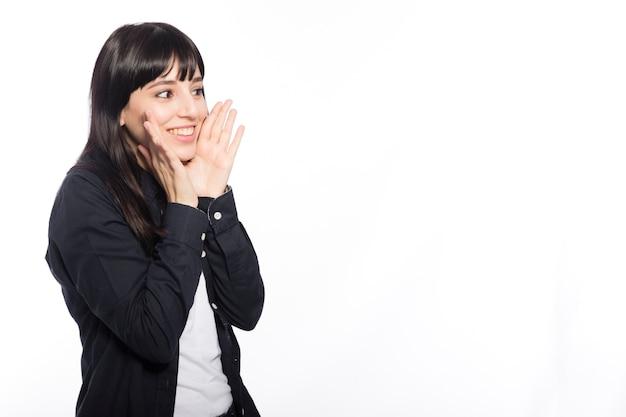 Cheerful woman telling secret