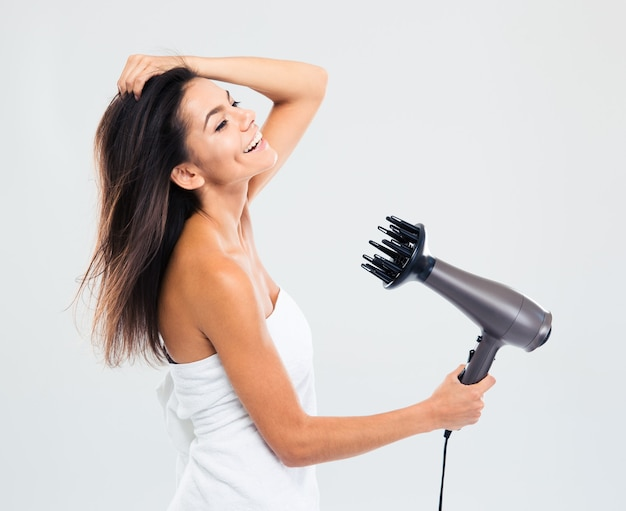 Cheerful woman in towel drying her hair