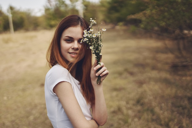 Cheerful woman walk in the field nature lifestyle summer