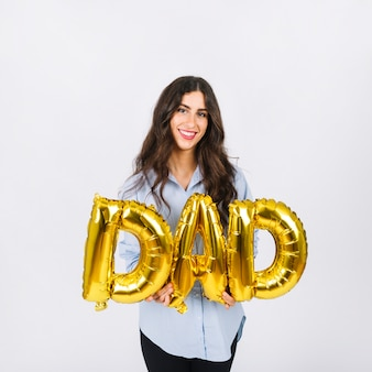 Cheerful woman with dad writing