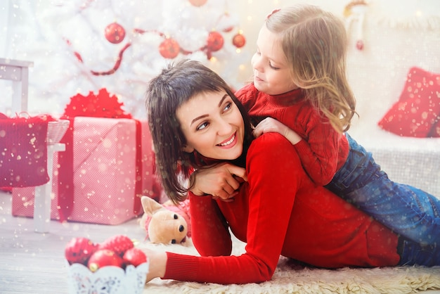 Cheerful woman with daughter in christmas time