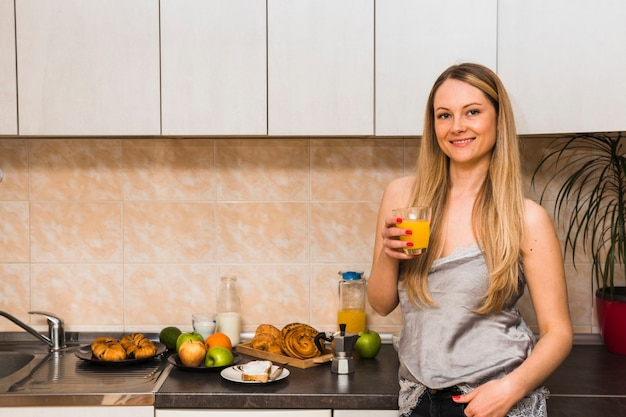 Cheerful woman with juice