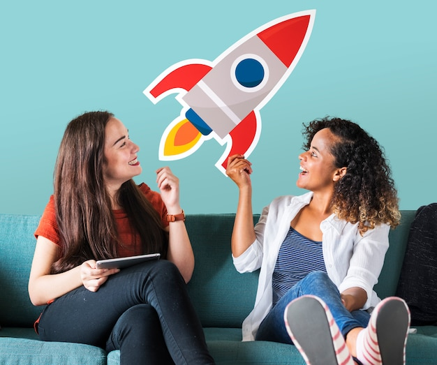 Cheerful women holding a rocket icon