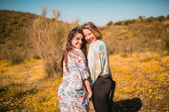 Cheerful women in field
