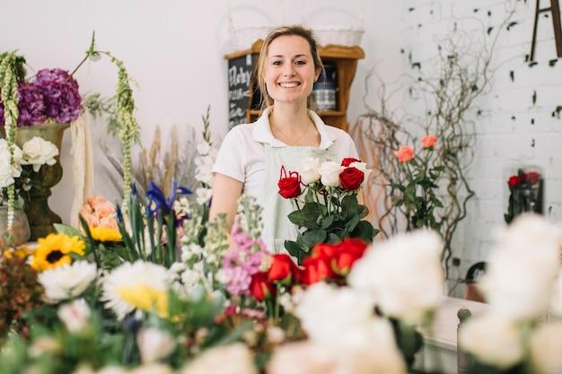 Cheerful worker of flower shop