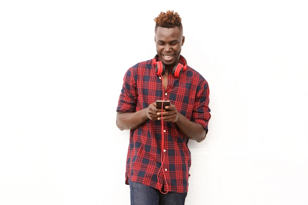 Cheerful young african american man with headphones