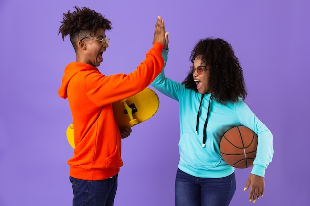 Cheerful young african couple standing