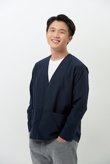Cheerful young asian in a bleu marine cardigan