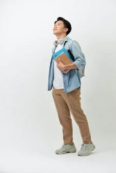 Cheerful young asian student with a backpack