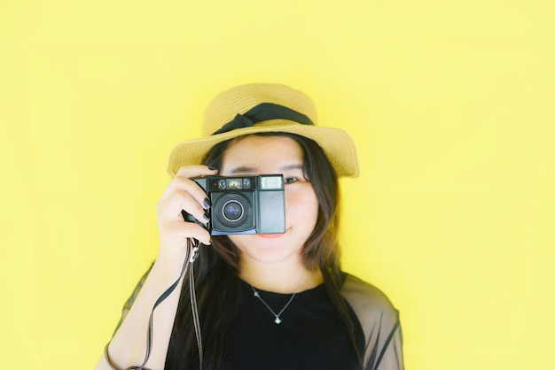 Cheerful young asian woman take picture