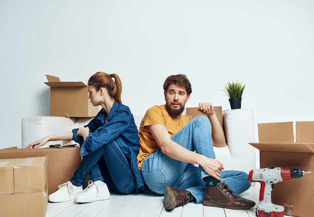 Cheerful young couple boxes with things new housing family. high quality photo
