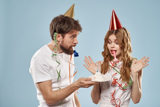 Cheerful young couple holiday birthday fun blue background