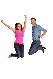 Cheerful young couple jumping