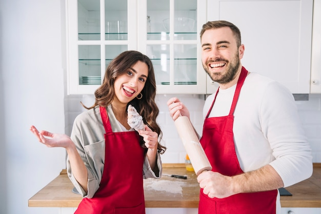 Cheerful young couple on kitchen
