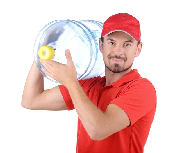 Cheerful young deliveryman holding a water jug.