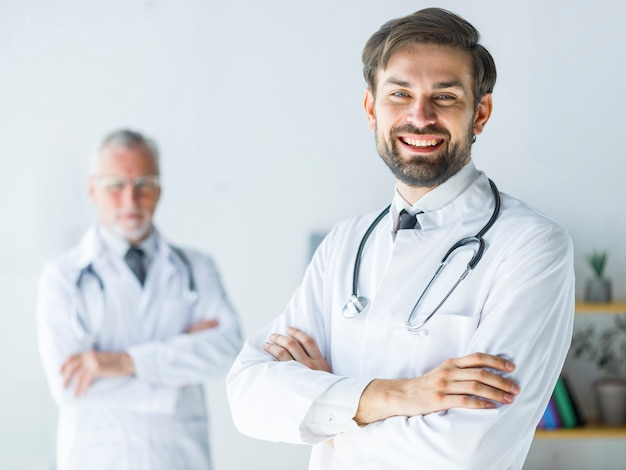 Cheerful young doctor in office