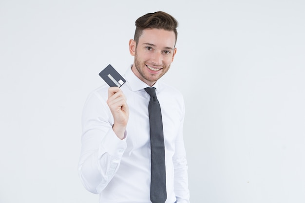 Cheerful young executive using credit card
