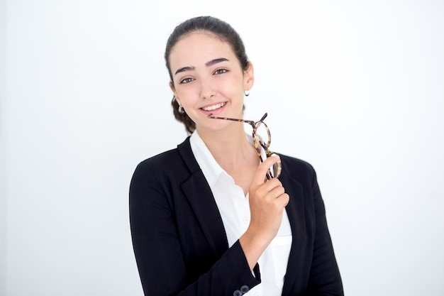 Cheerful young female leader holding glasses