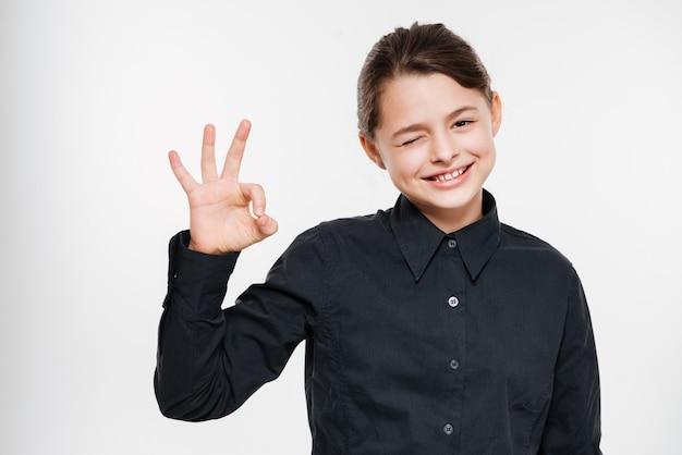Cheerful young girl make okay gesture