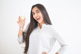 Cheerful Young Indian Woman Raising Glass of Wine