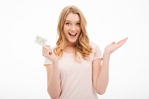 Cheerful young lady holding credit card.
