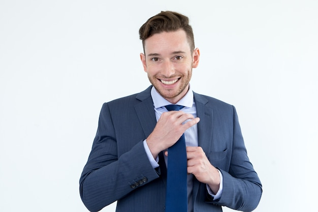 Cheerful young man preparing for important meeting