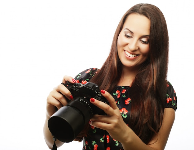 Cheerful young woman making photo