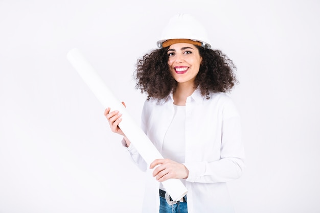 Cheerful young woman with blueprints