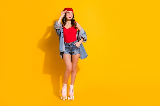 Cheerful youngster teen girl enjoy roller skates sporty weekend