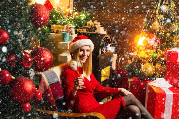 Cheers girl enjoy cozy atmosphere christmas eve pleasant moments christmas joy woman decorated inter...