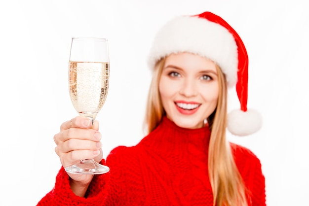 Cheers! happy santa girl holding glass of champagne