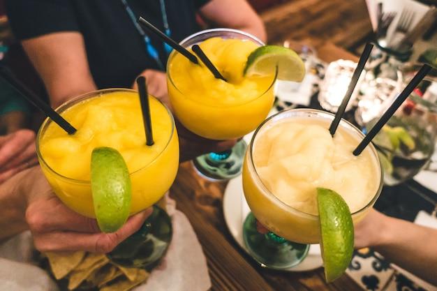Cheers with frozen margaritas