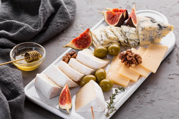 Cheese assortment platter with fig
