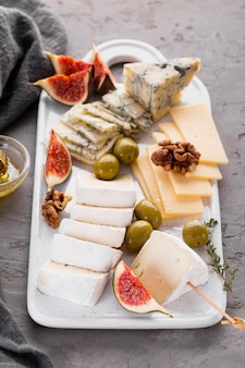 Cheese assortment platter with olives