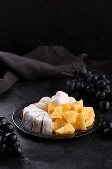 Cheese assortment with black grapes