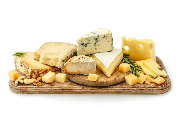 Cheese assortment on wooden plate