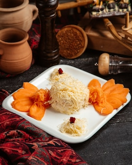 Cheese ball and sliced apricot