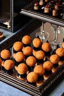 Cheese balls in batter on a tray