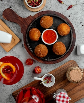 Cheese balls with barbecue sauce top view