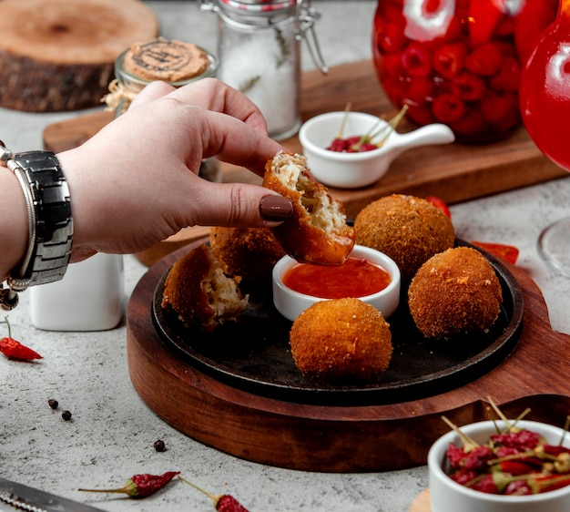 Cheese balls with barbecue sauce